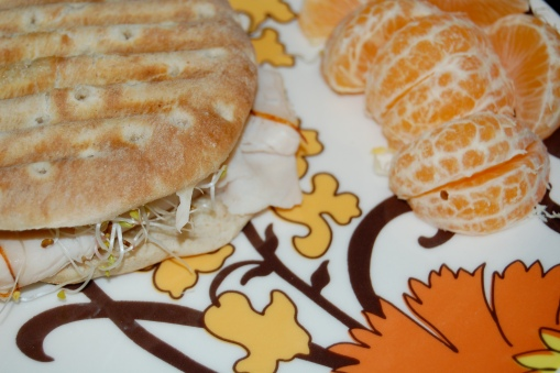 Turkey and low-fat Cabot Cheddar panini with sprouts, clementine